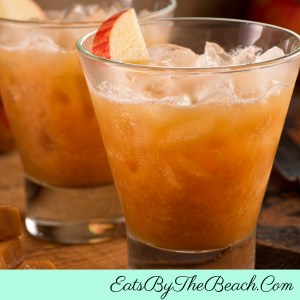 A perfect Autumn drink - a highball glass of Caramel Apple Cider Cocktails with caramel vodka, butterscotch schnapps, and apple cider.