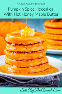 A stack of pumpkin spice hoecakes with hot honey maple butter and maple syrup luxuriously dripping down the sides.