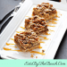 Pecan pie bars drizzled with caramel sauce on a white platter.