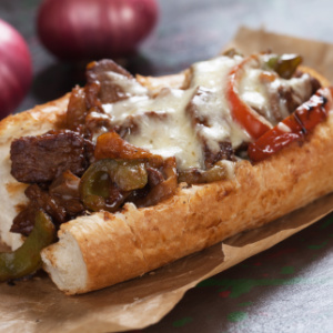 A Philly Cheesesteak sandwich with provolone cheese.