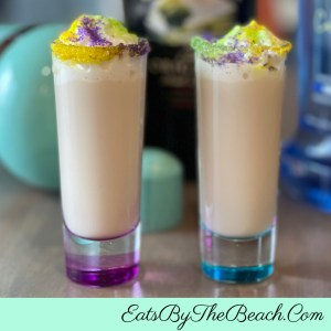 Cool, creamy King Cake Shots - cake vodka, Baily's, Cinnamon Schnapps, and cream