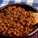 Bean pot of Kansas City Barbecue Beans -beans that are sweet, tangy, spicy, and full of barbecue flavor. Perfect for a Super Bowl party!