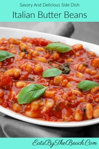 Bowl of vegetarian Italian Butter Beans - butter beans stewed in a zesty tomato sauce and garnished with fresh basil.