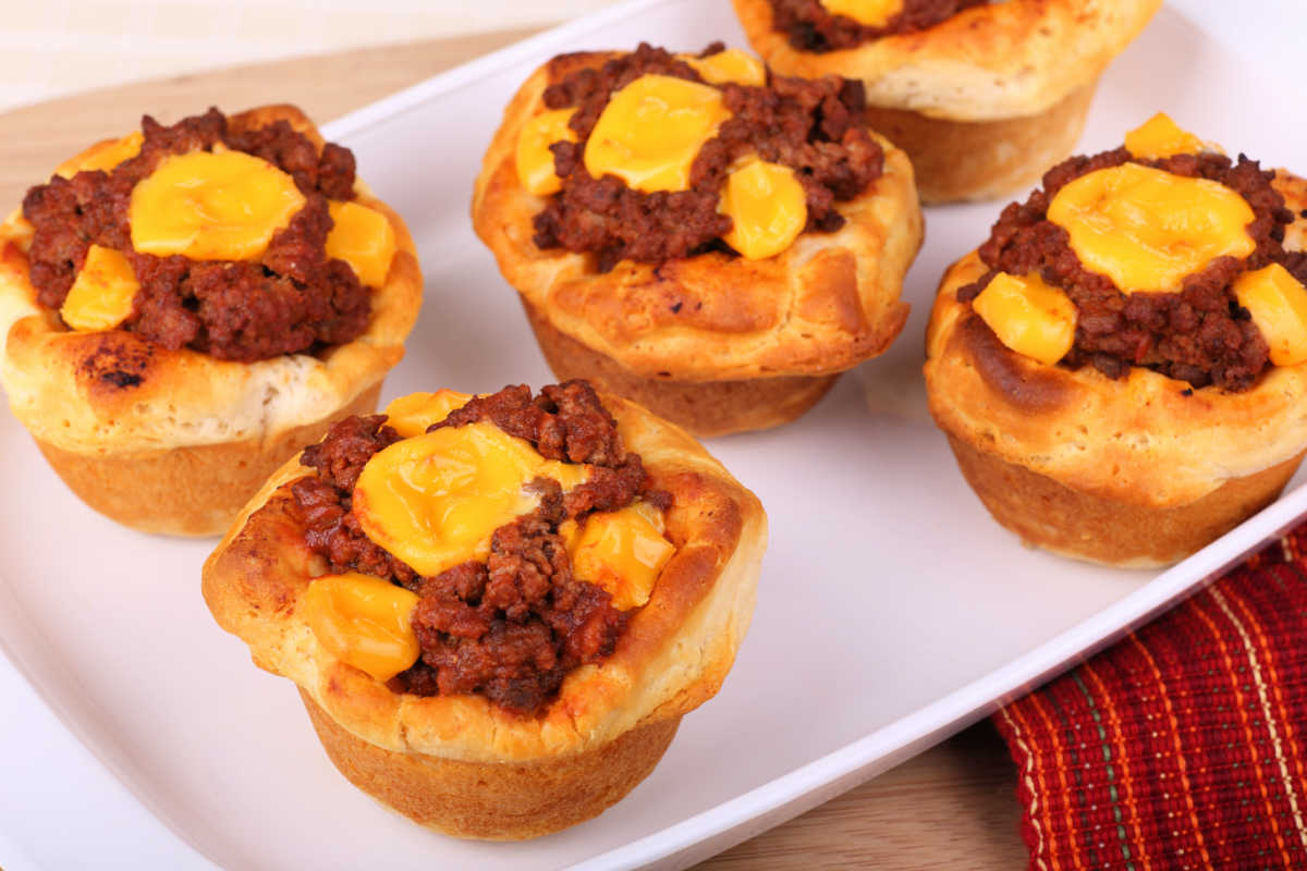 Sloppy Joe Biscuit Cups are cups made from biscuit dough and stuffed with homemade sloppy joe mixture and topped with cheddar cheese.