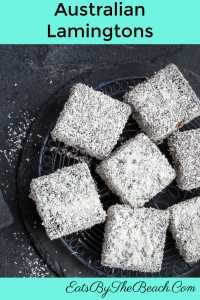Slate tray of Australian Lamingtons - buttery cake squares that are dipped in a chocolate syrup and rolled in dessicated coconut. Typically served at high tea.
