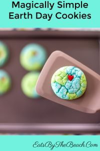 Plate of magically simple Earth Day cookies - blue and green sugar cookies that look like the earth with a red heart in the middle