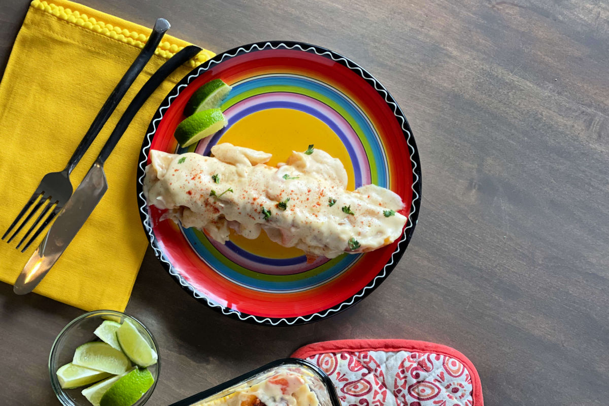 A pan of creamy, Seafood Enchiladas - a Chi Chi's copycat recipe - shrimp and crab in a creamy, cheesy sauce and baked to golden perfection.