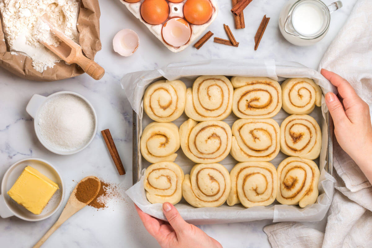 Pan of easy cinnamon rolls to bake with some of the ingredients.