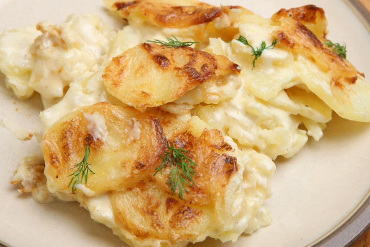 A closeup of a serving of creamy scalloped potatoes