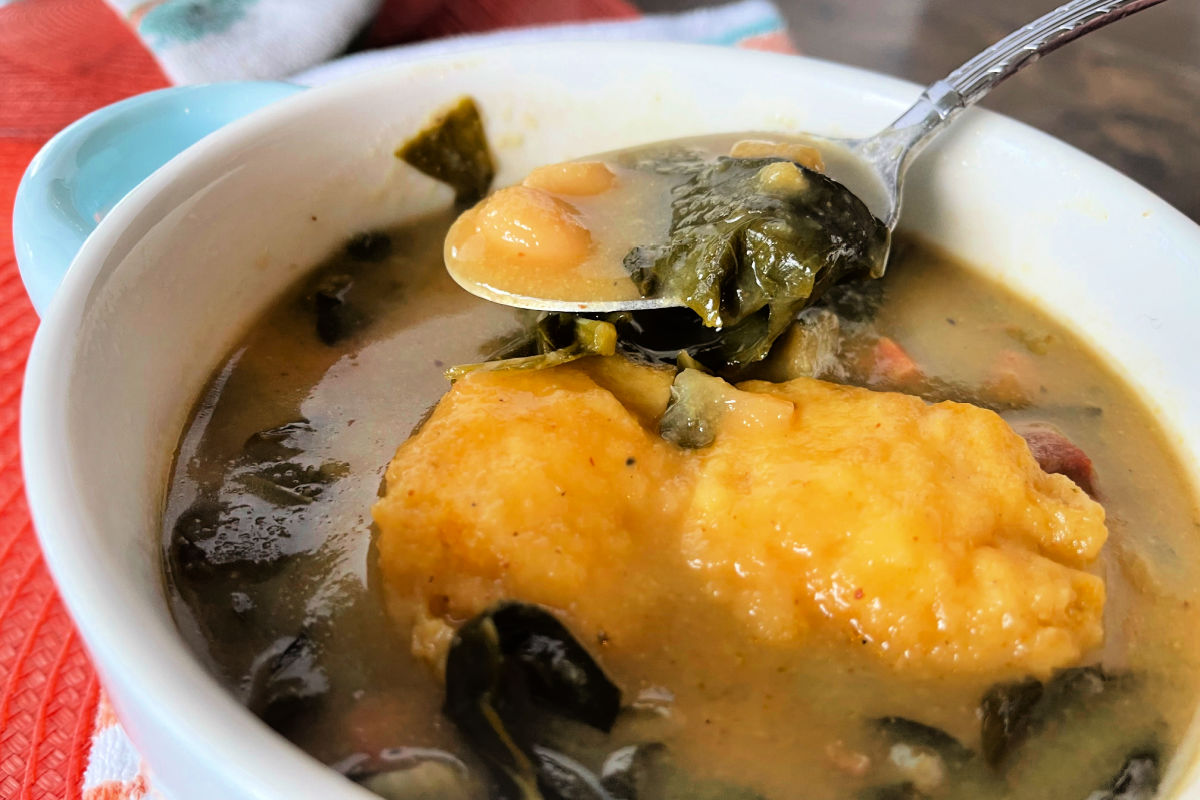 Bowl of stewed Beans And Greens With Corn Dodgers - a cornmeal dumpling