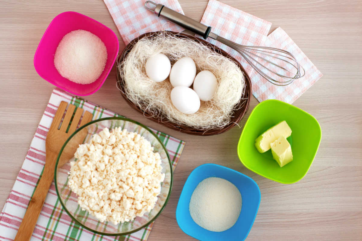 Ingredients for Russian Breakfast Cheesecake - eggs, cottage cheese, sweetened condensed milk, butter, vanilla