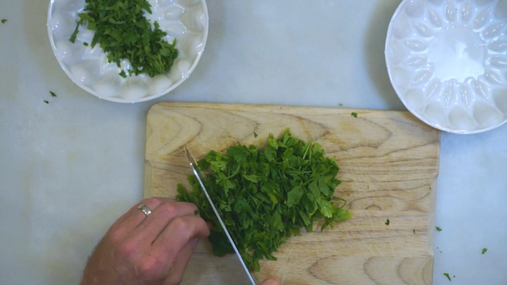 Chopping parsley for Spicy Chimicurri Sauce