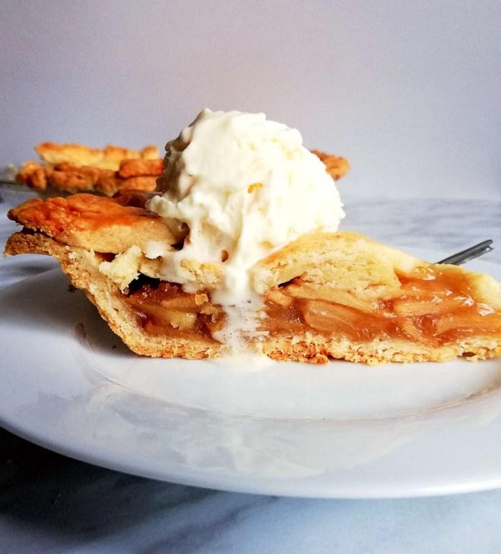 apple pie slice with ice cream side view