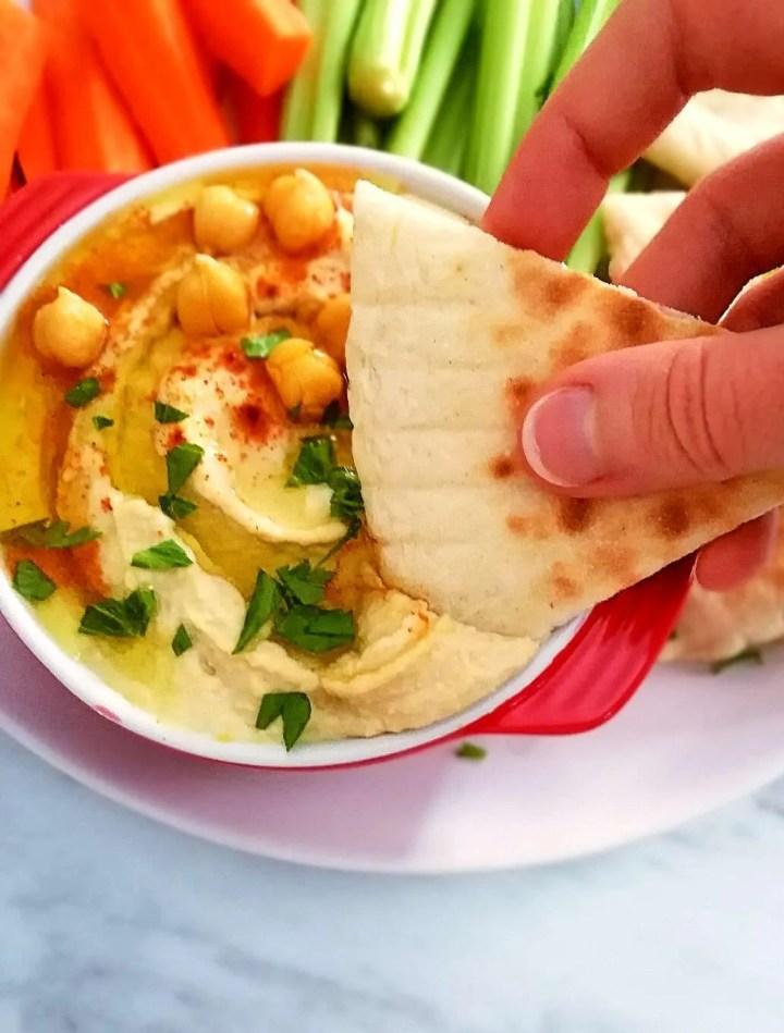pita bread dipped in hummus
