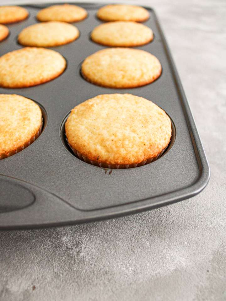 easy vanilla cupcakes in cupcake tin side view
