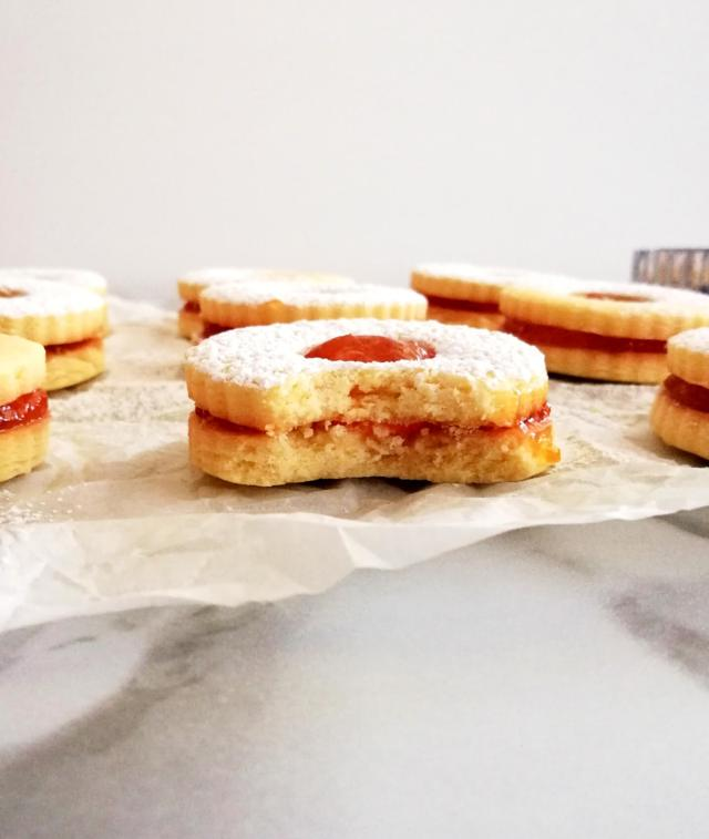 apricot jam filled sandwich cookies one cookie bitten