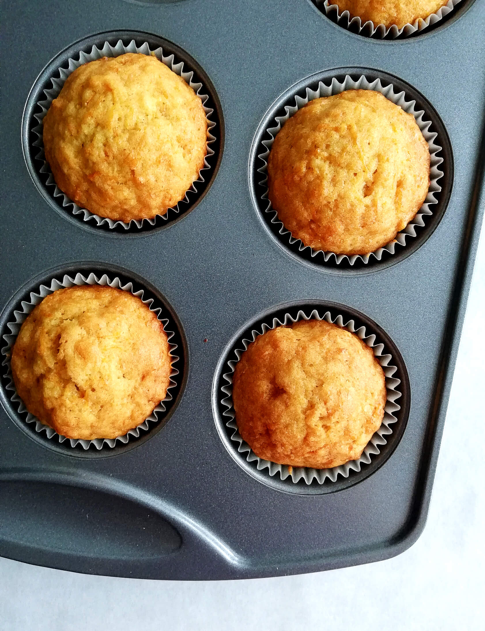 carrot cake muffins in muffin tin