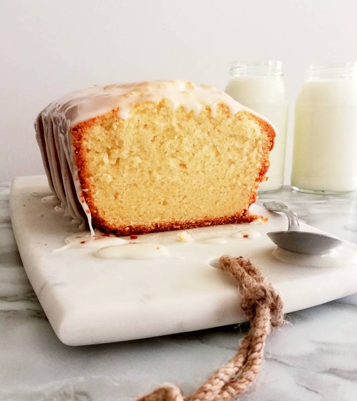 sour cream pound cake topped with icing inside texture head on view