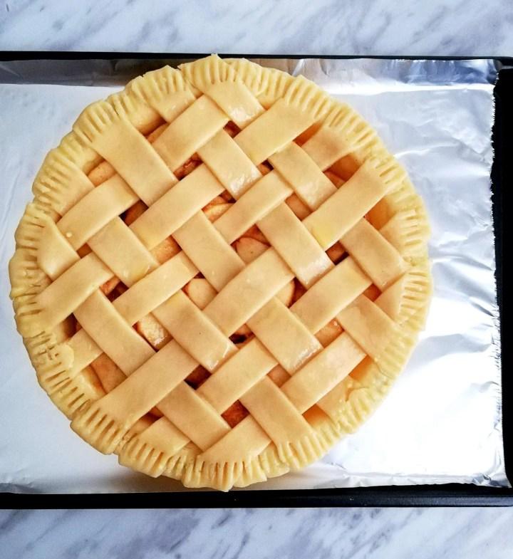 apple pie on baking sheet