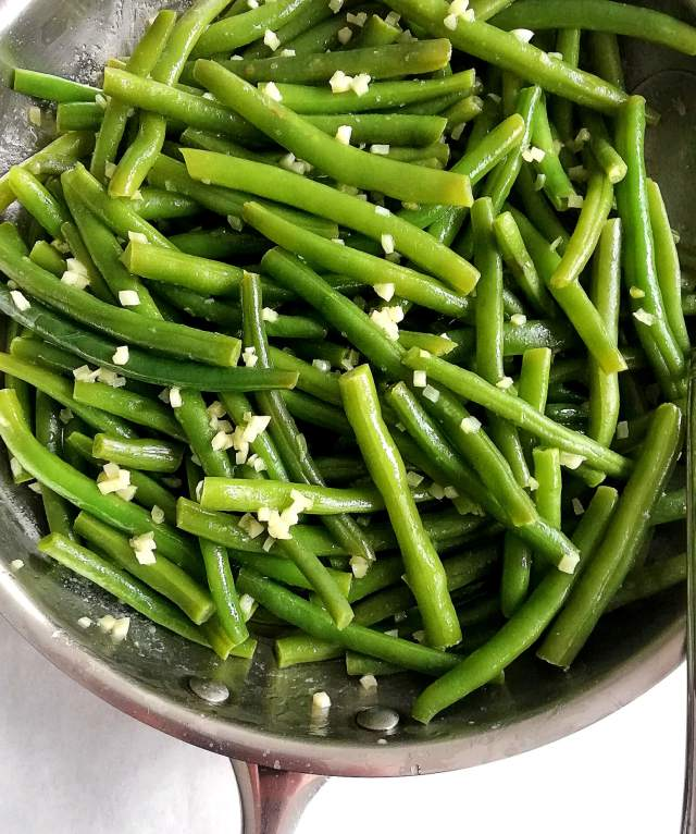 garlic green beans in skillet close up
