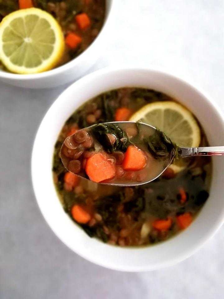 spinach lentil soup in spoon
