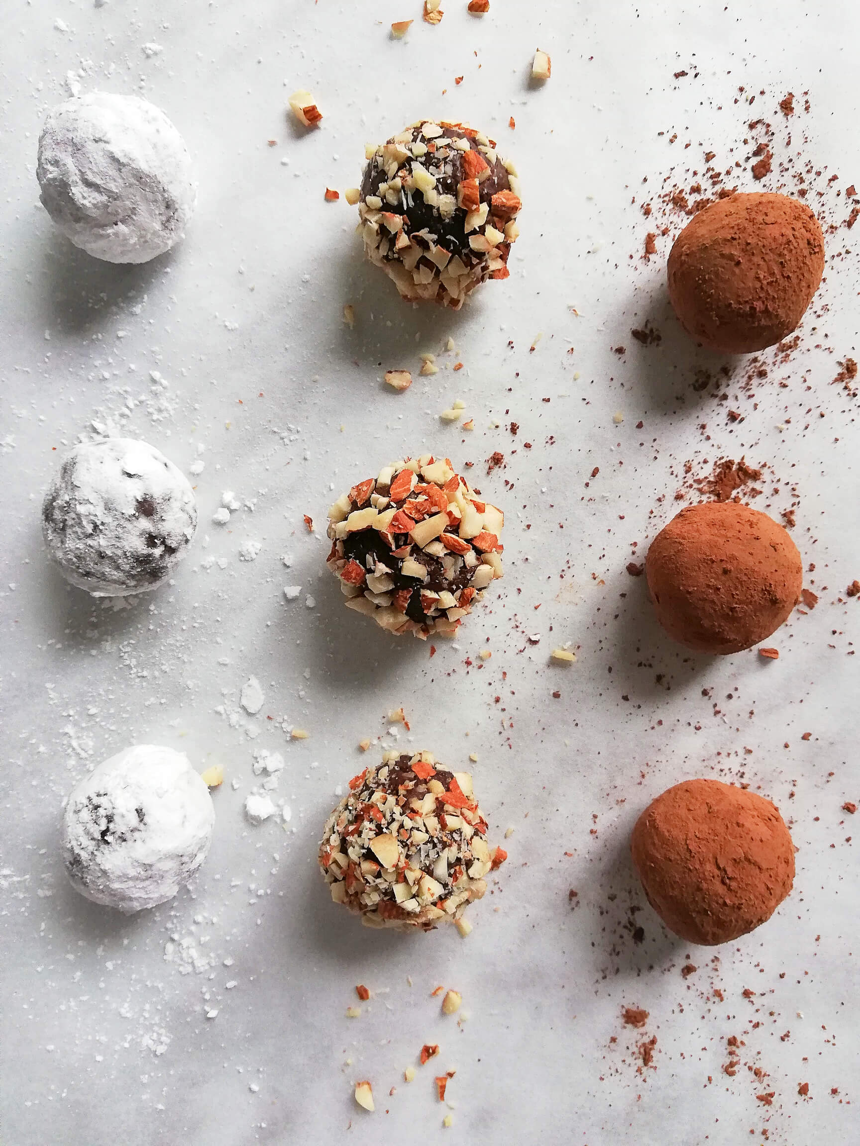 chocolate truffles rolled in powdered sugar, nuts, cocoa