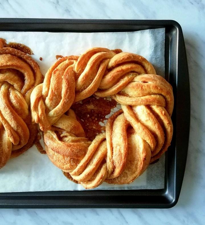 cinnamon swirl wreath bread baked on baking sheet