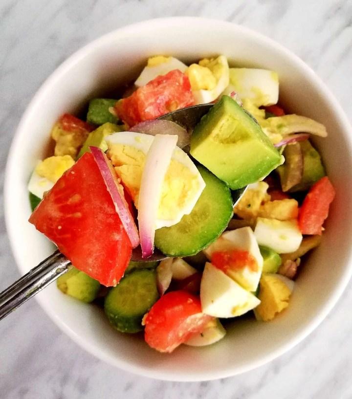 egg and avocado salad on spoon