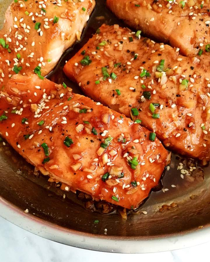honey garlic salmon in skillet close up
