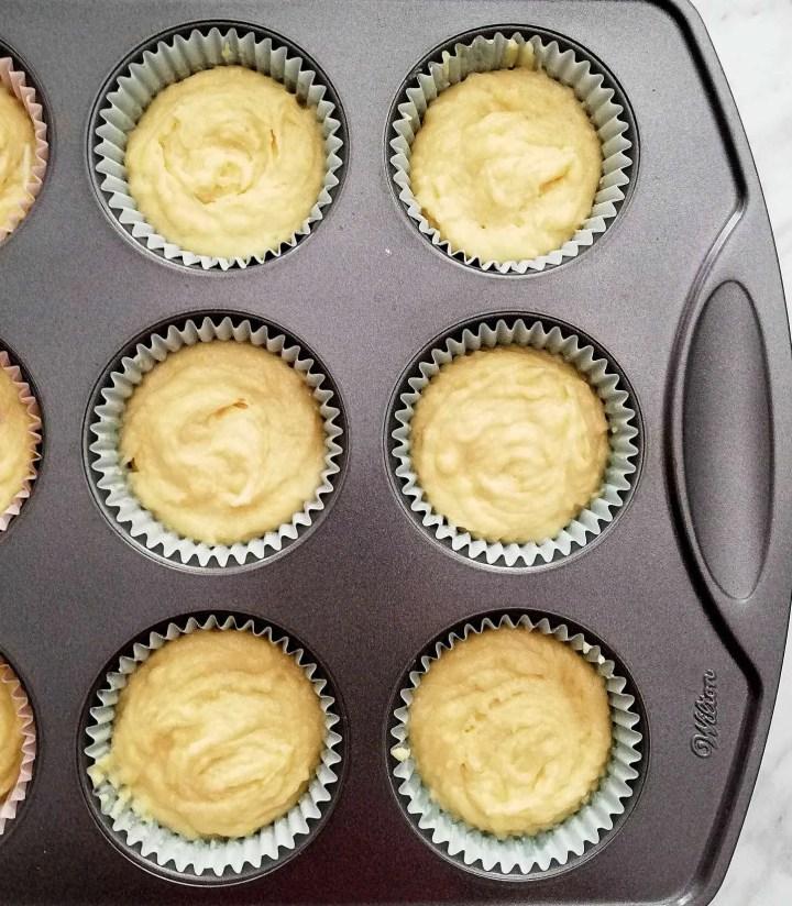 sour cream vanilla cupcakes batter in cupcake tin