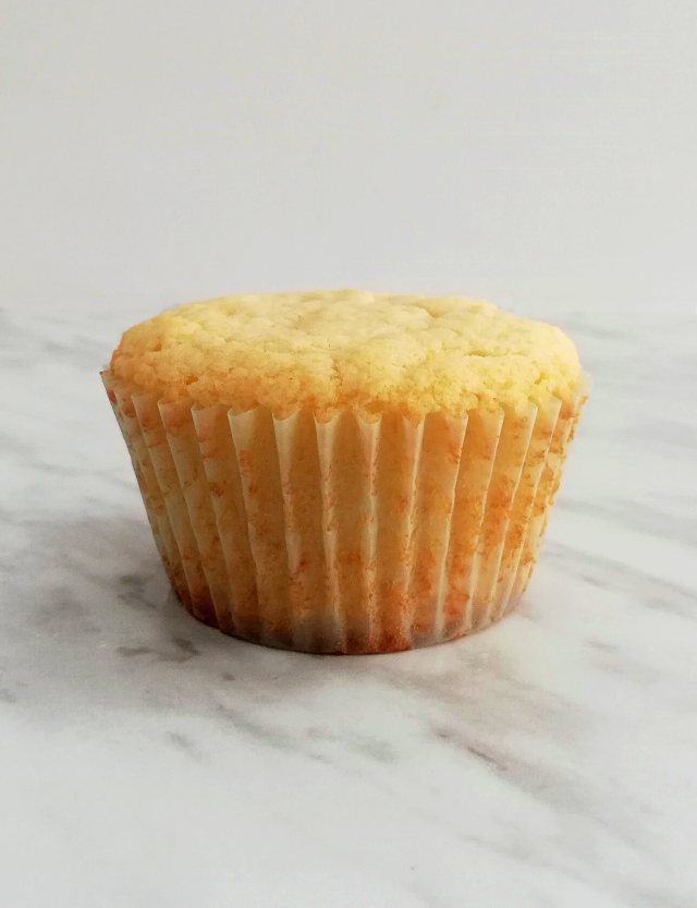 sour cream vanilla cupcakes one unfrosted