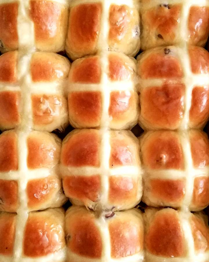 Easter hot cross buns baked and glazed overhead image
