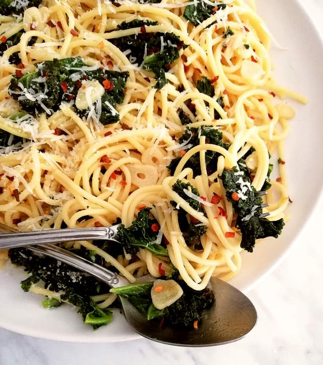 spicy kale pasta on fork close up