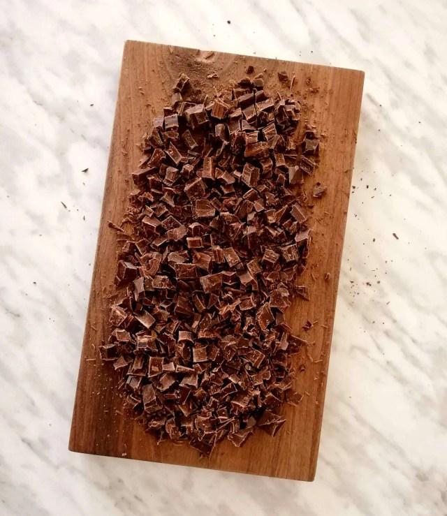 whipped chocolate ganache chopped chocolate on cutting board
