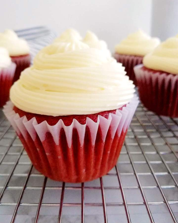 cream cheese frosting on red velvet cupcakes close up (1)