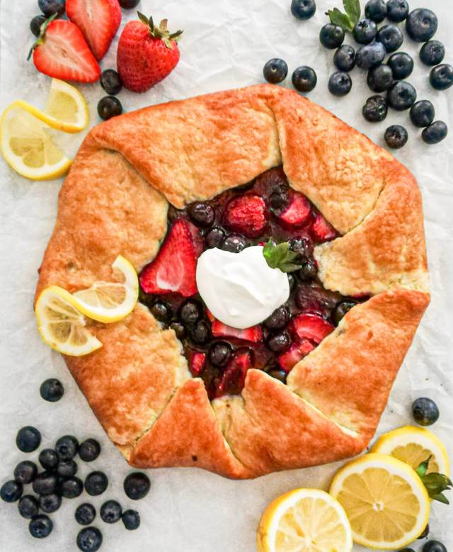 mixed berry galette topped with whipped cream
