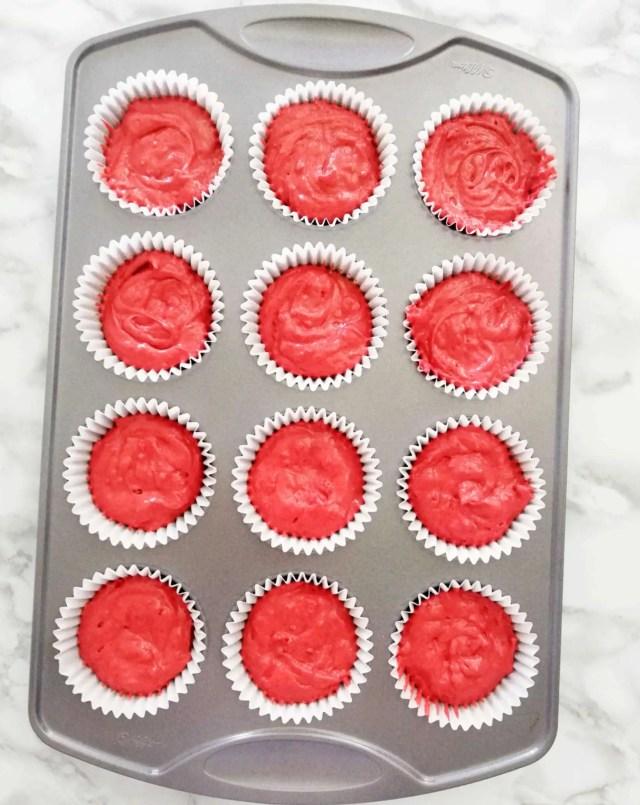 red velvet cupcakes batter in cupcake tin overhead image
