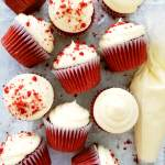 red velvet cupcakes lined up on parchment paper overhead image