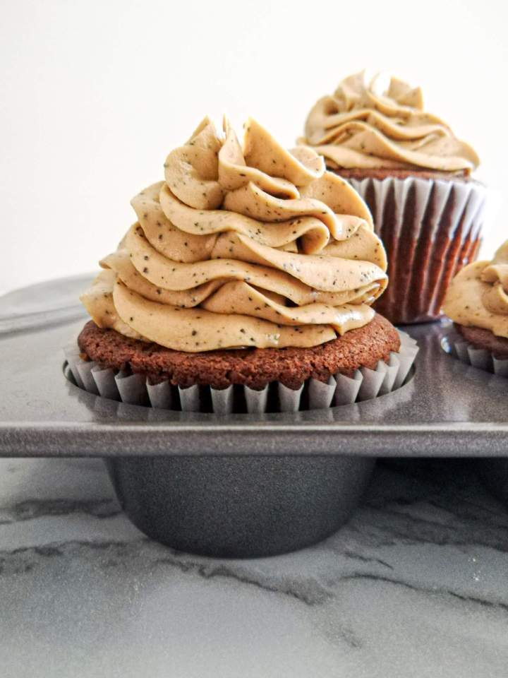 espresso buttercream frosting on cupcakes in cupcake tin