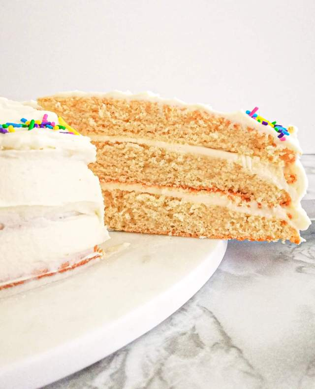 vanilla birthday cake without a cake pan slice in cake side view (1)