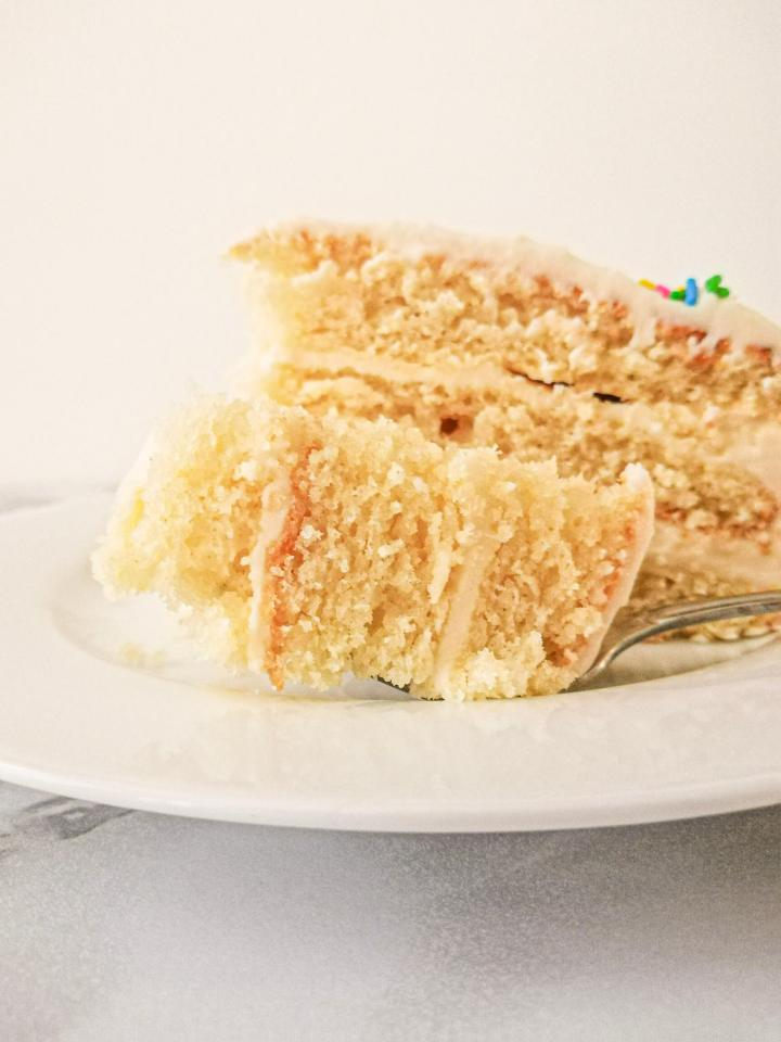 vanilla birthday cake without a cake pan slice with bite missing side view