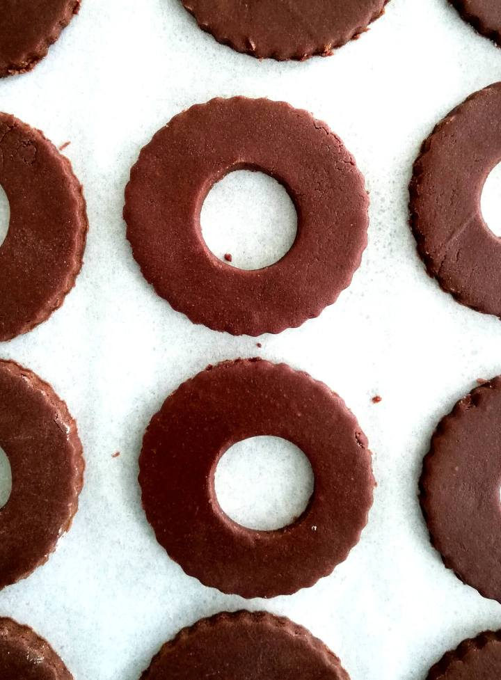 double chocolate sandwich cookies dough cut out with center hole for top cookies