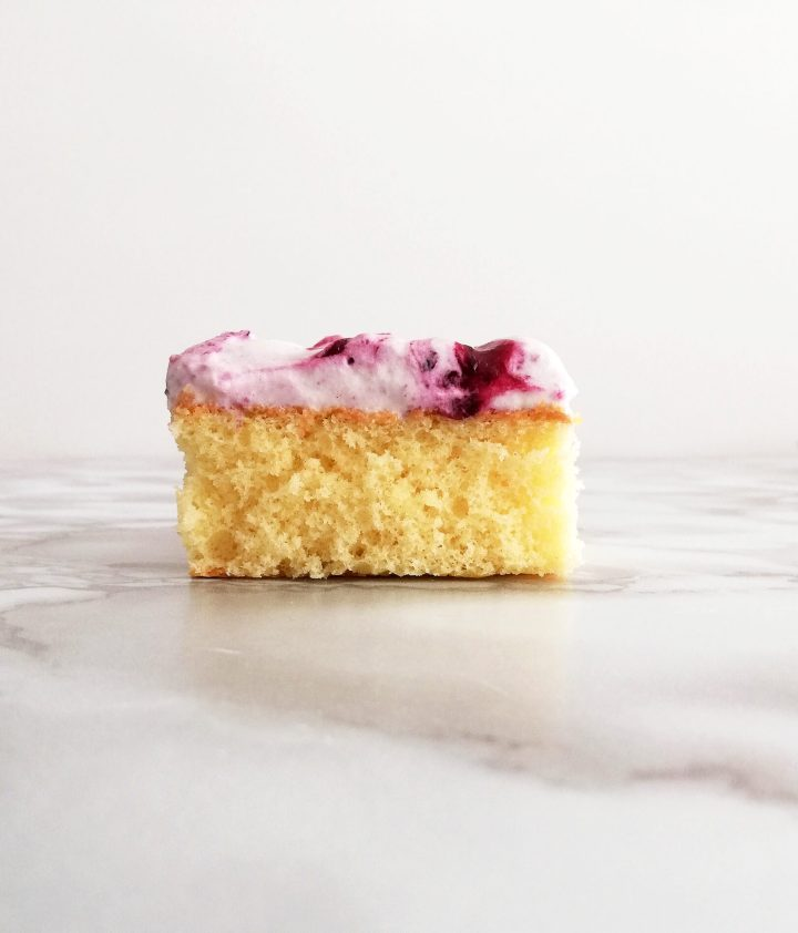genoise cake with blueberry swirl whipped cream slice on table head on view (1)