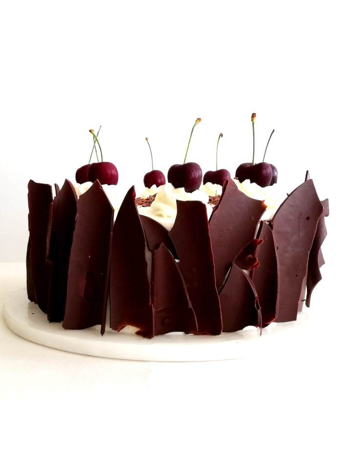 black forest cake on cake platter head on view