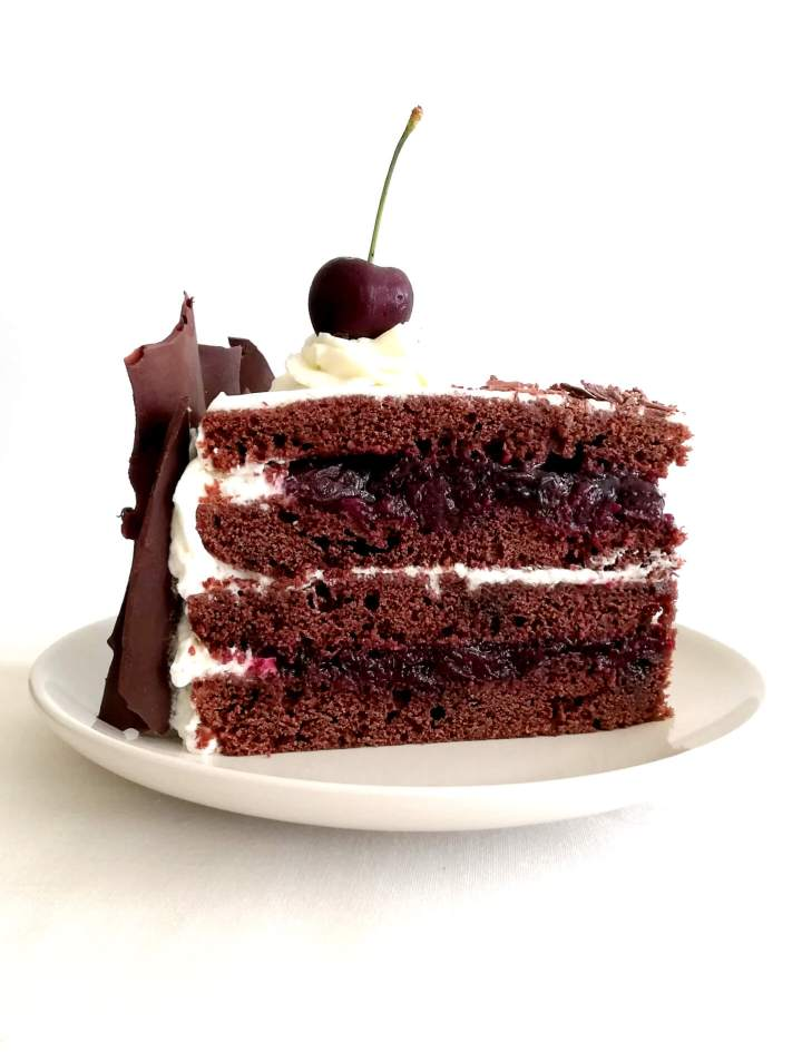 black forest cake slice in plate head on view