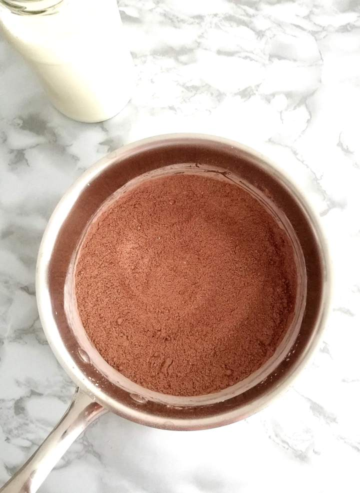 chocolate pudding dry ingredients whisked together in pot