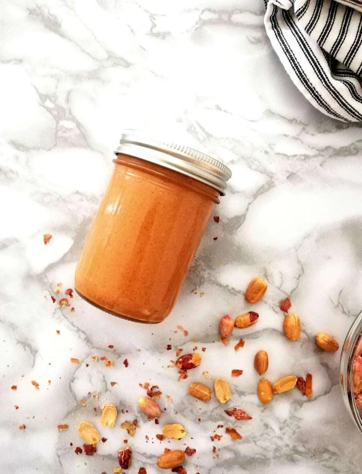 homemade peanut butter in jar lying down flat overhead image
