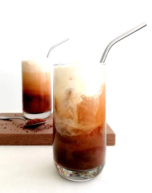 iced coffee in cups with whipped cream poured in (1)