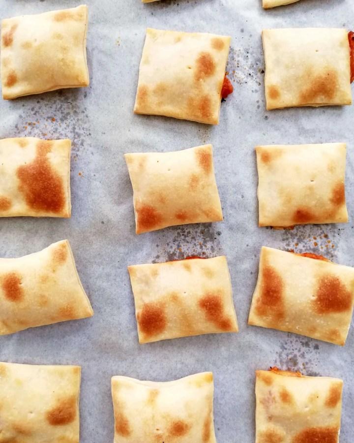 mini pizza bites baked on baking sheet