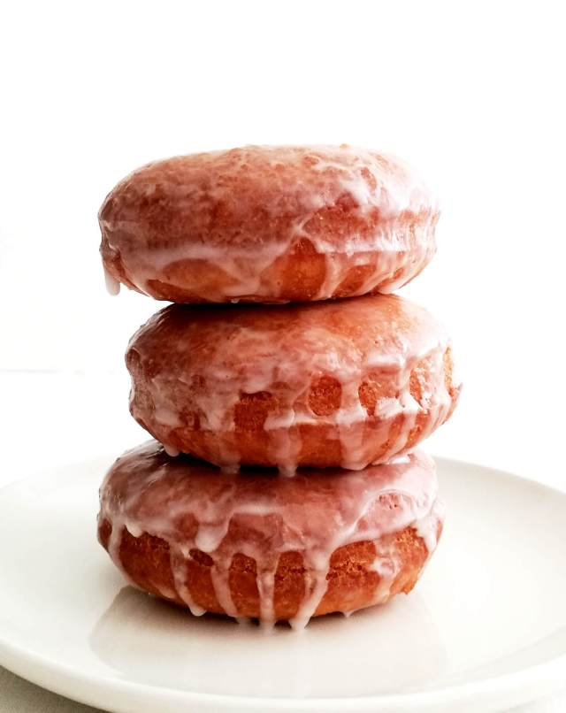 sour cream glazed donuts 3 stacked on top of each other
